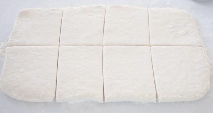 dough rolled out and cut into squares