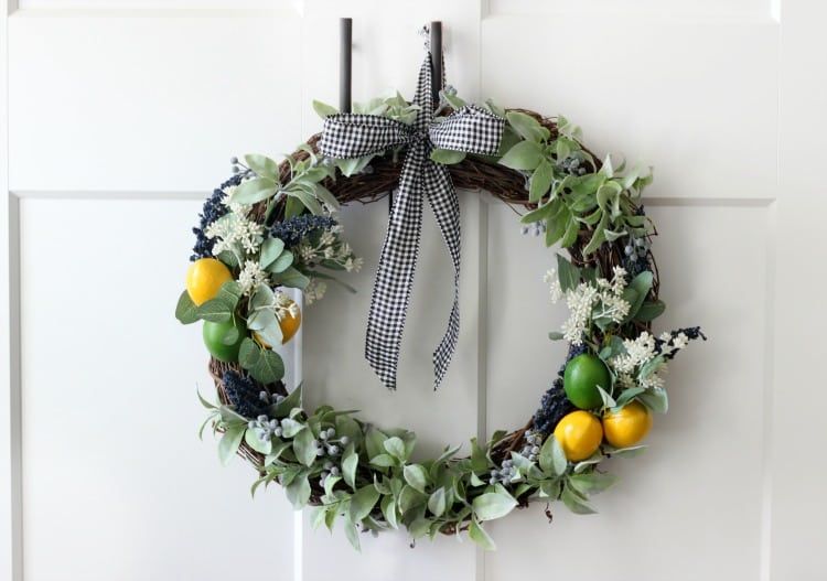 Bright pops of citrus combine with greenery and gingham for an adorable & easy wreath to make this summer!