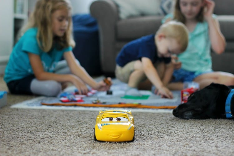 Make arace track play mat to inspire creative play in your home! This double sided mat is soft to sit on and folds up for easy storage. The perfect place to play with your favorite cars and trucks!