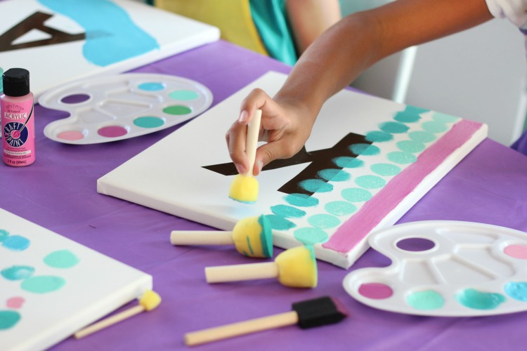 This painting party for kids is such a fun activity! Everyone gets to go home with a one-of-a-kind party favor---a painting for their bedroom!