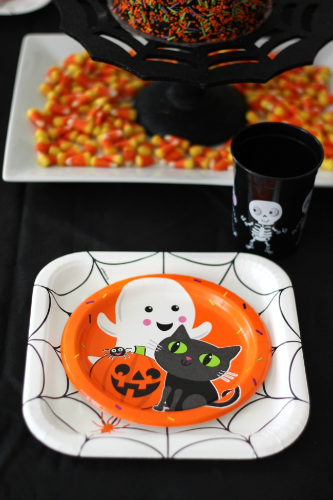 white halloween plate with small plate in center. halloween place setting