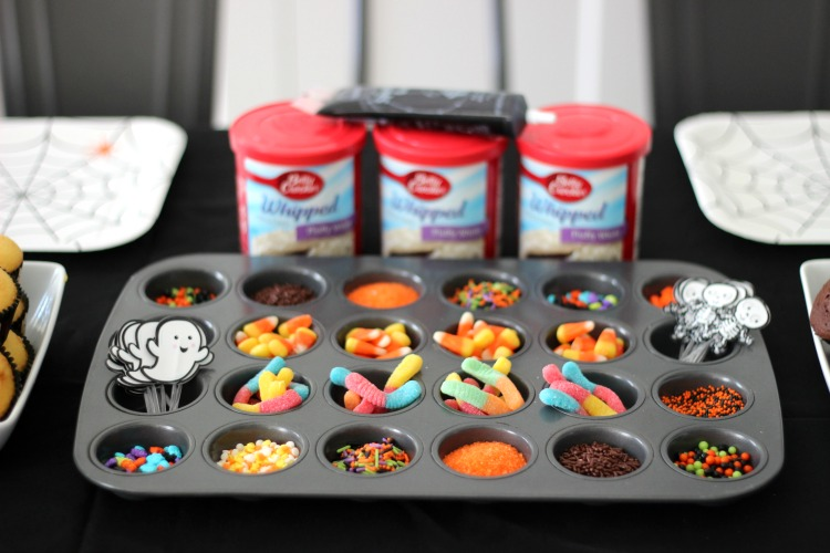 toppings for cupcake decorating party. sprinkles, gummy works, frosting