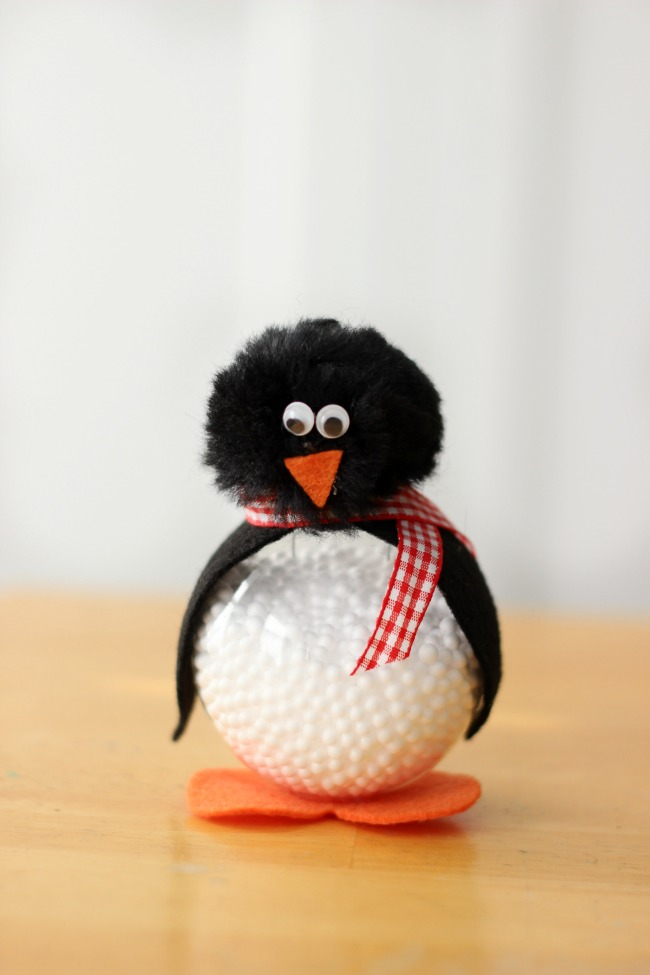 Make a darling penguin craft out of a clear ornament! Add a hanger to use during the holidays, or keep it on a shelf. Kids will love making these cute penguins this winter!