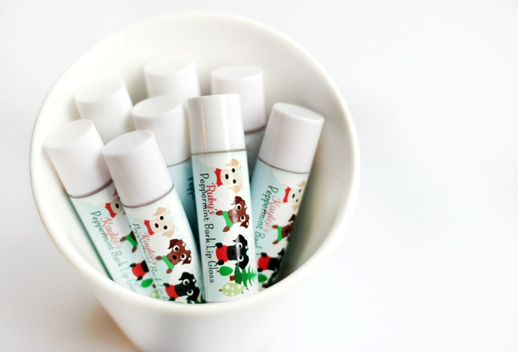 Peppermint bark scented homemade lip balm with cute holiday wrappers! An easy project for kids to help with and they make great holiday gifts!