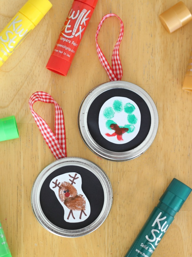 reindeer ornaments made from thumbprints and canning jar lids