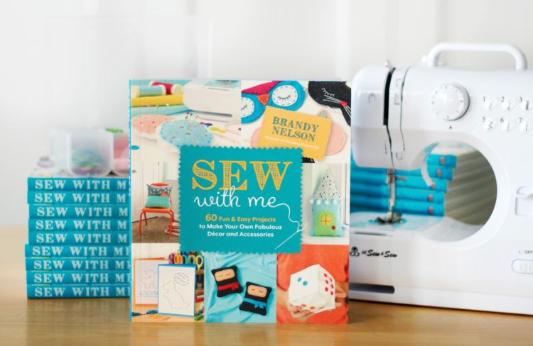kids sewing book and sewing machine