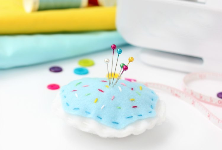 felt pin cushion with pins in it