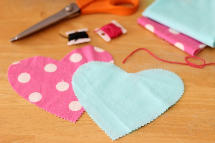 These DIY heart plushies come together quickly, and are a great beginning sewing project for kids! Fill with stuffing, dried lavender or beans!