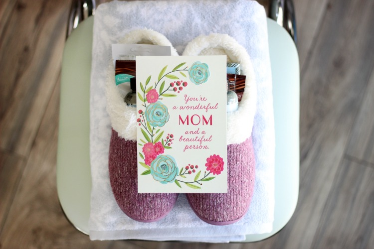 slippers with mothers day card placed on top