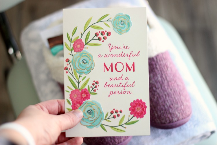 hand holding Mother's Day card