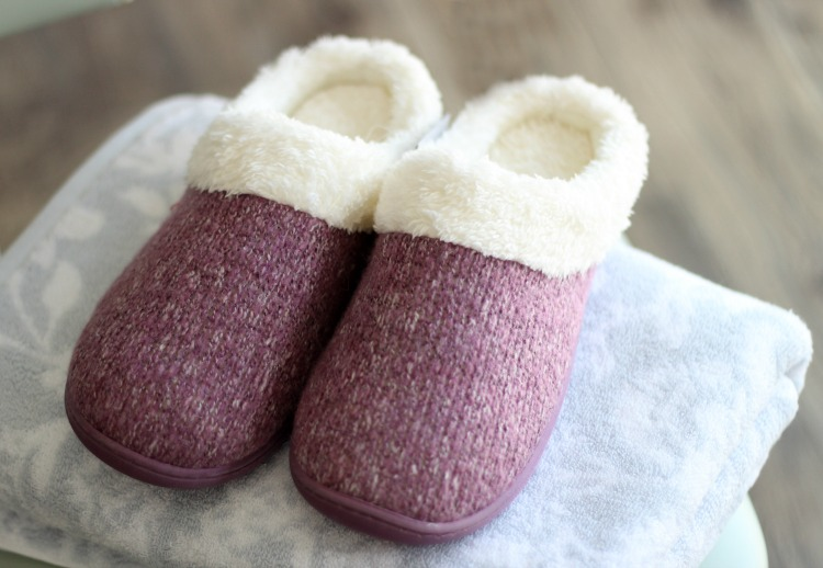towel folded with slippers on top