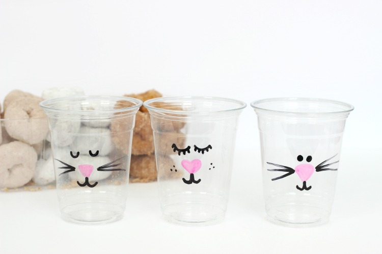 photo of cups decorated with sharpie paint pens