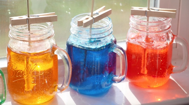 jars of rock candy syrup in window