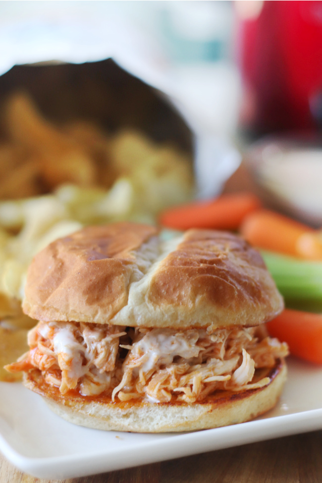 slow cooker buffalo chicken sandwich on white plate