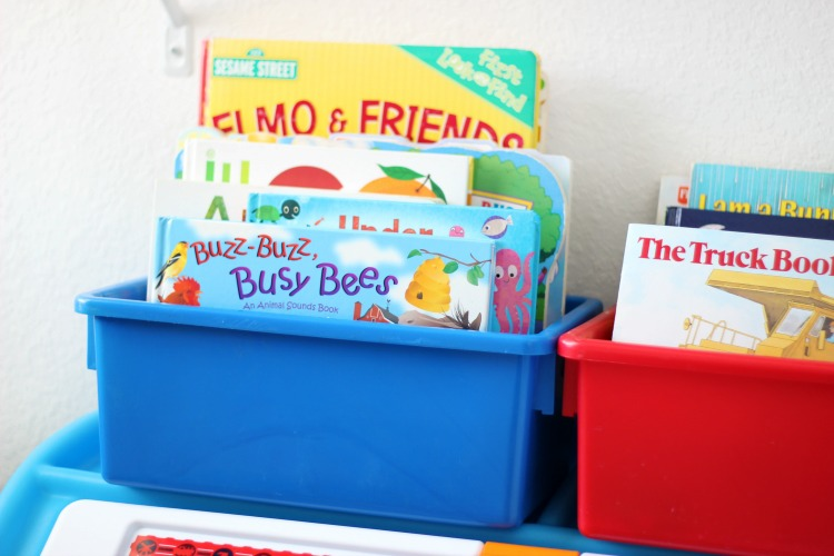 book bins in toddler bedroom