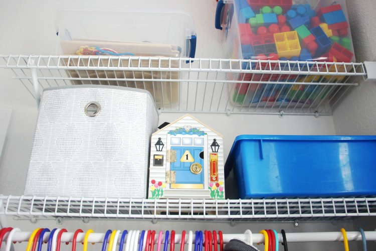 shelving with bins of toys