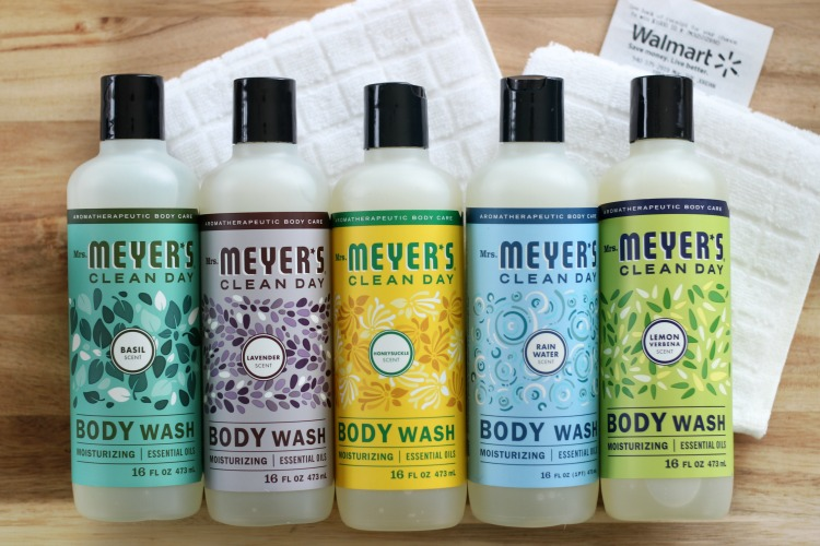 bottles of mrs meyers body wash lined up on table