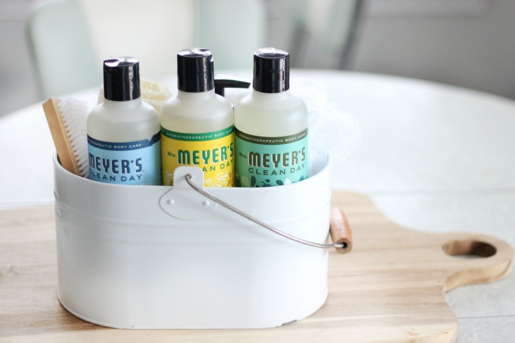 mrs meyers bath and body gift basket set on table