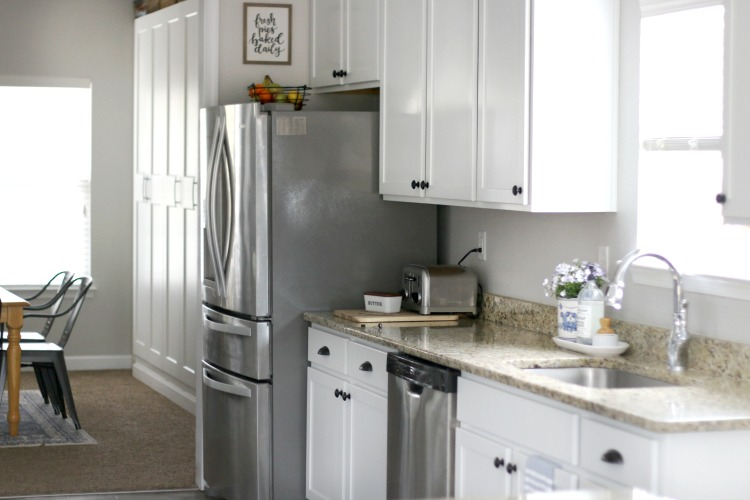 kitchen with refrigerator granite countertops and sink