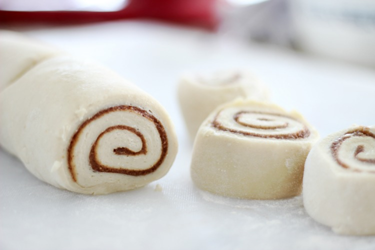 cinnamon rolls sliced and ready to bake