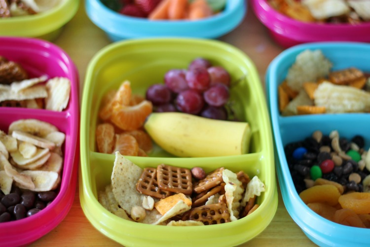 snack containers sectioned off with fruit and snack mix