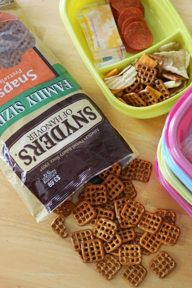 pretzels on table with container filled with road trip snacks
