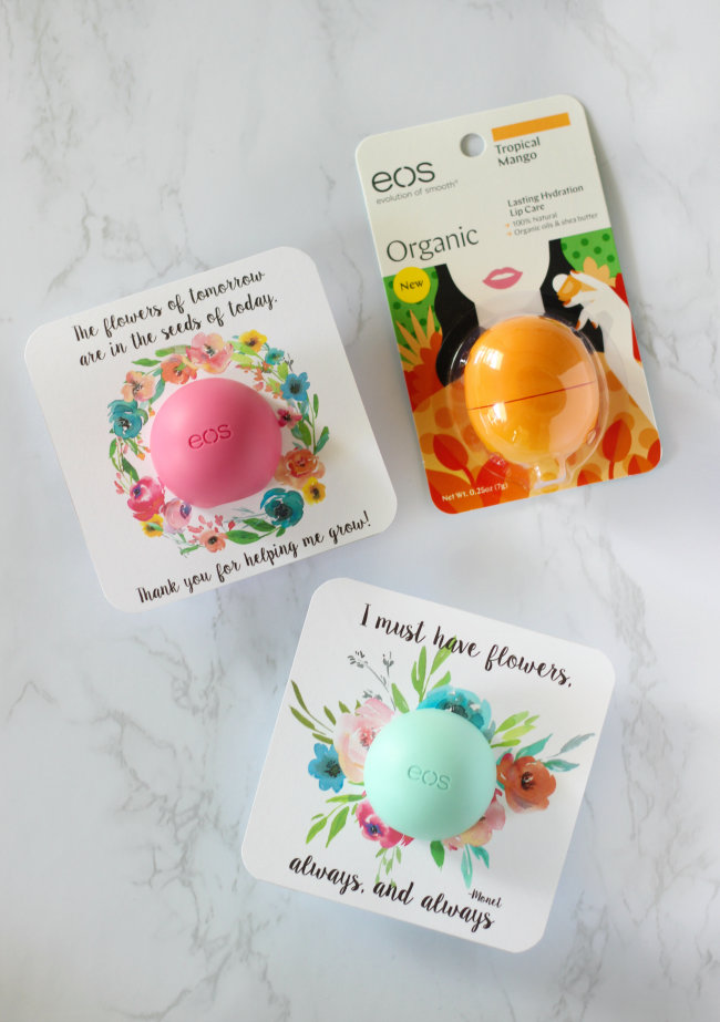 3 EOS lip balms on work surface