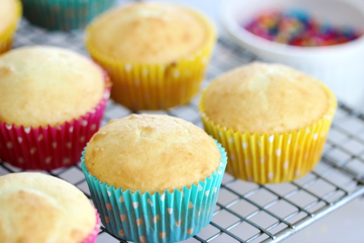 white cupcakes on cooling rack