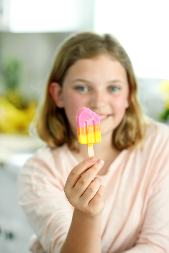 child holding finished candy popsicle