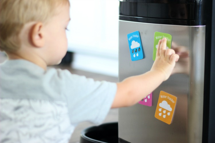front of water dispenser with printable water tracker magnet