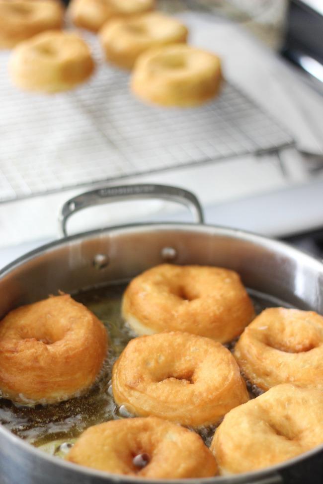 golden biscuit dough donuts frying in oil