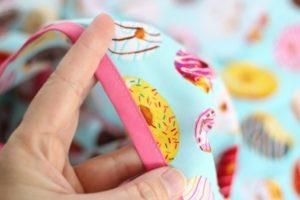 stitch bias tape around bag opening