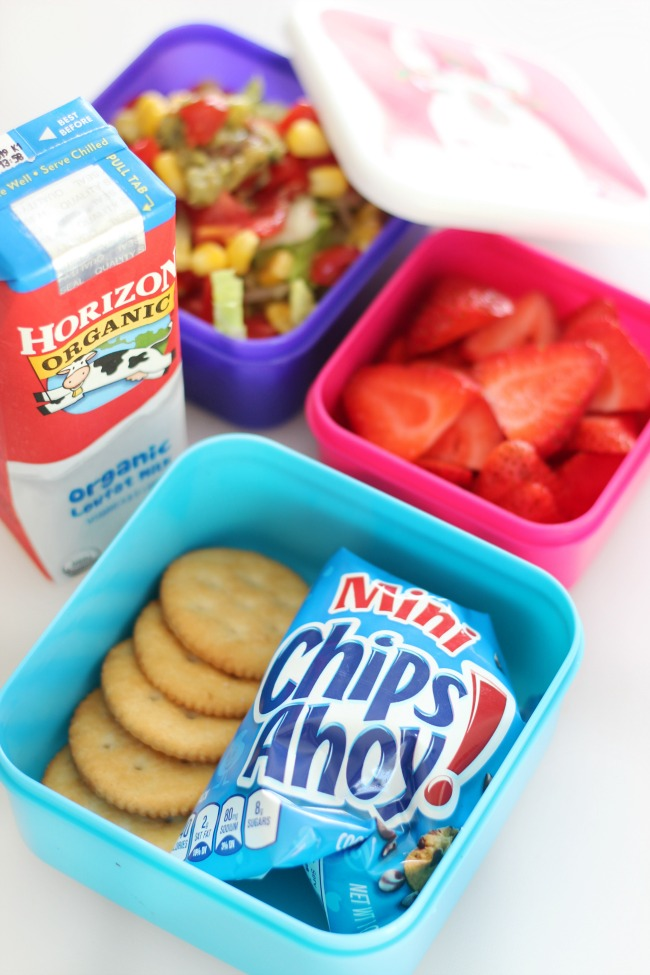 lunch containers with cookies and crackers, strawberries and milk box