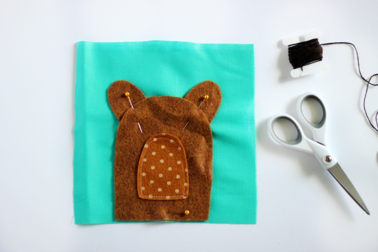 front of rice pack with teddy bear pieces pinned into place