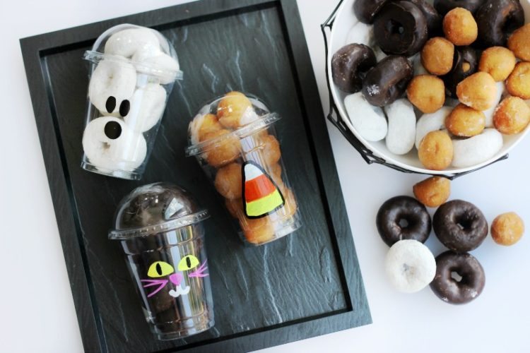 black platter with 3 cups of halloween donut cups