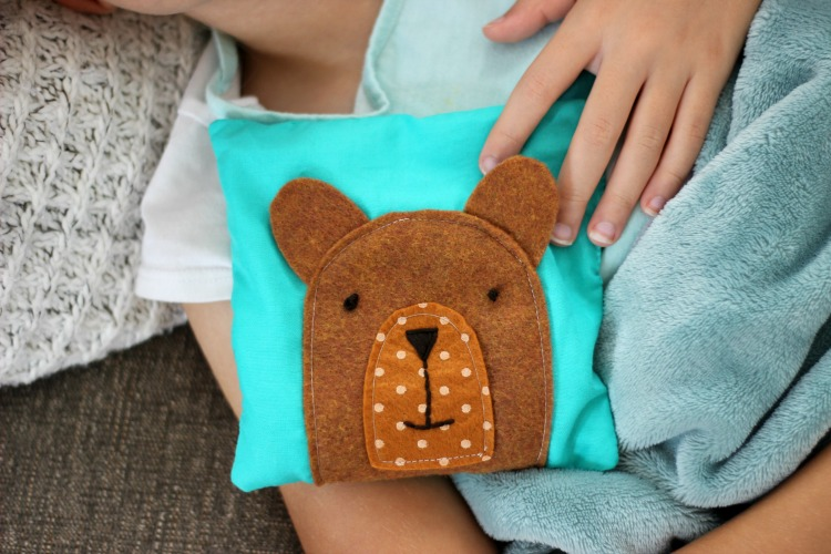 teddy bear rice pack with child
