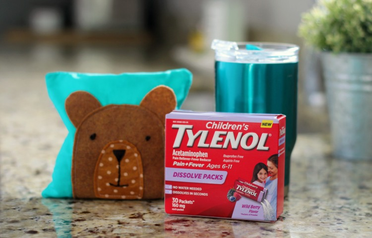 box of children's tylenol on counter next to rice pack
