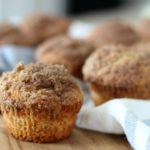 apple cider muffin on cutting board