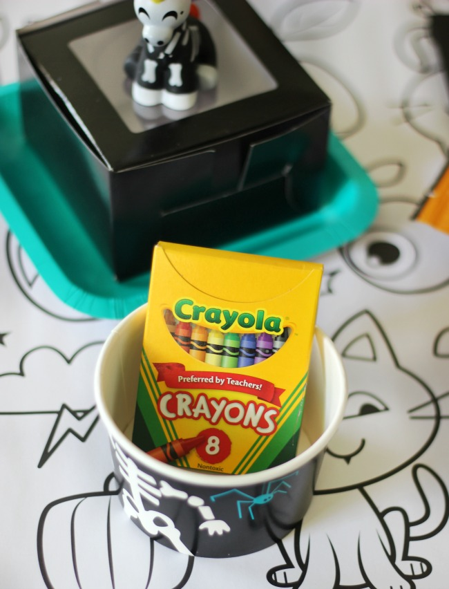 halloween coloring table cloth with a cup of crayons
