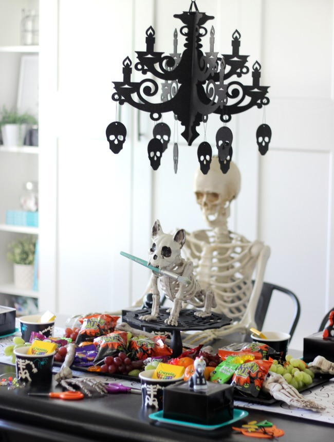 halloween party for kids with skeletons and art supplies