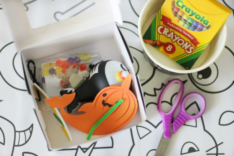 black craft box with halloween craft kits inside