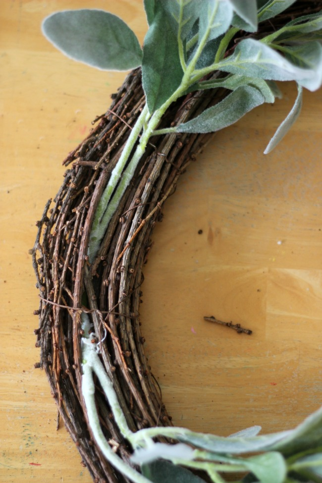 grapevine wreath with stems tucked in between vines