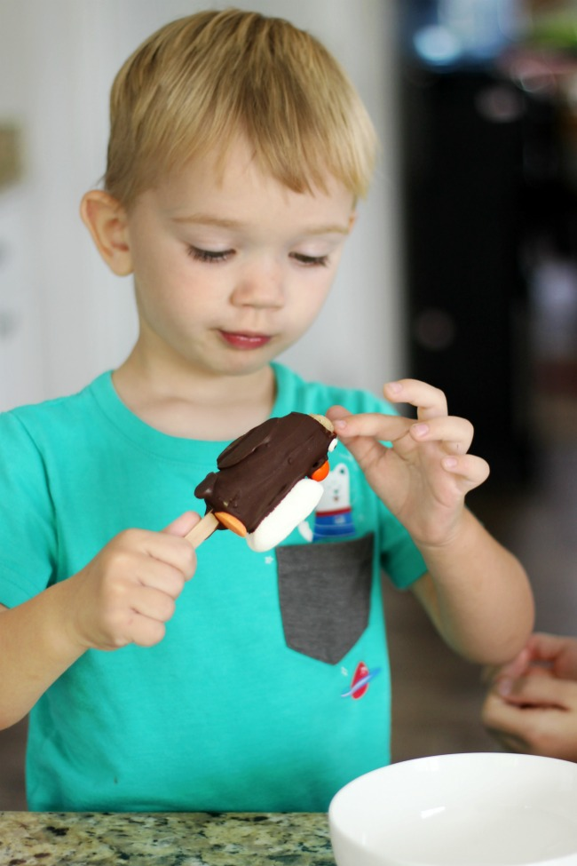 toddler making edible crafts chocolate penguin
