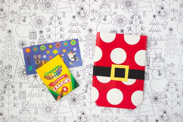 crayons and stickers to put inside wrapping paper bags