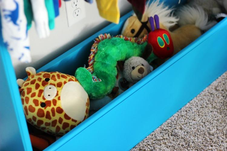 kids wardrobe storage bin with stuffed animals