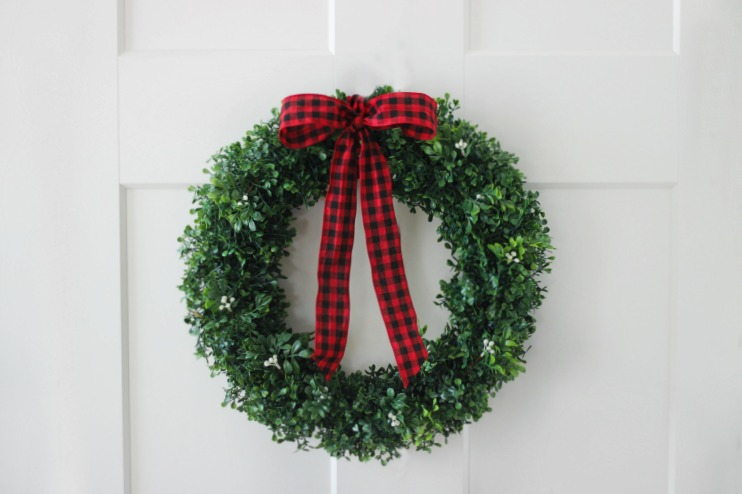 holiday boxwood wreath red ribbon