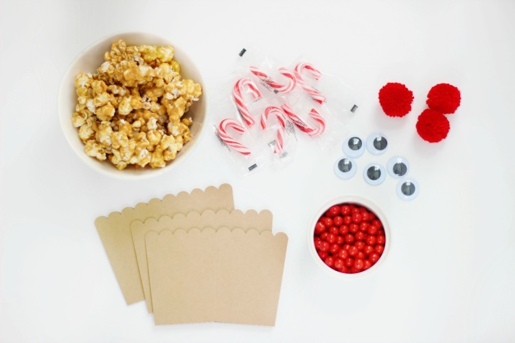 popcorn boxes, caramel popcorn, candy canes, candy, eyes pom poms