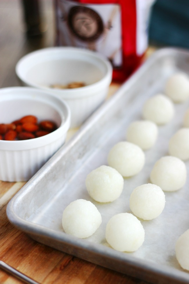 coconut balls ready to dip into chocolate
