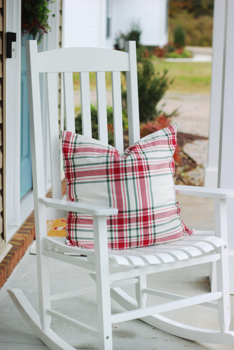 holiday throw pillow on front porch