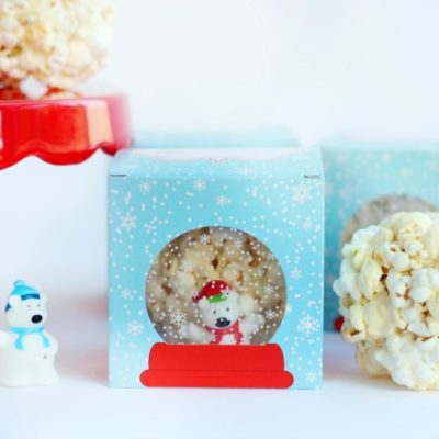 popcorn balls on cake stand and inside gift boxes